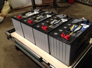Four Group 31 AGM batteries installed on back cover of amp rack